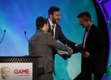Chris O'Dowd and Miles Jacobson welcome Keith Ramsdale to the stage to accept the award for Use of Online of behalf on the development team behind FIFA 10 (BAFTA/Brian Ritchie)