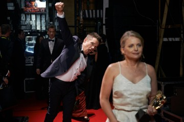 Ethan Hawke and Cathleen Sutherland celebrate backstage at London's Royal Opera House after Boyhood wins the BAFTA for Film in 2015.
