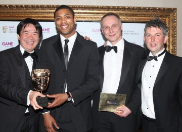 Presenter Delon Armitage with with Joe Wee, Andy Needham and Chris Byatte from publisher Chillingo, collecting the BAFTA on behalf of Efim Voinov, Semyon Voinov of Zeptolab whose work on the physics-based title for iOS was praised by the jury for its chal