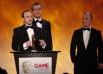 Rocksteady Studios, the creators of  Batman Arkham Asylum, take to the stage to accept the award for Gameplay. Those pictured include Rocksteady co-owners Sefton Hill and Jamie Walker (BAFTA/Brian Ritchie)