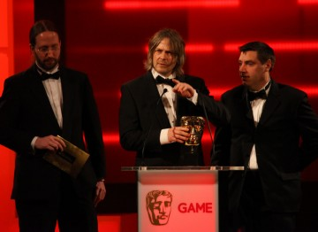 Mark Healey, David Smith and Pete Smith accept the BAFTA for Game Innovation.