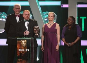BBC Four's Zimbabwe's Forgotten Children wins. Jezza Neumann, Xoliswa Sithole, Brian Woods and Deborah Shipley accept the award.