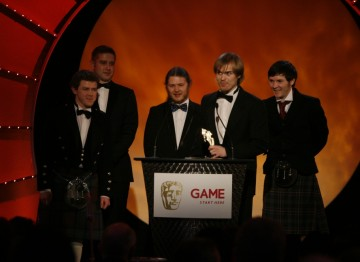 First time game creators Vykintas Kazdailis, Andrew Macdonald, Michael cummings, Jacek Wernikowski and Stuart Kemp gather on stage to accept the BAFTA Ones to Watch Award in Association with DARE to be Digital for Shrunk! (BAFTA/Brian Ritchie)
