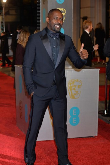 Supporting Actor nominee Idris Elba works the cameras at this years red carpet