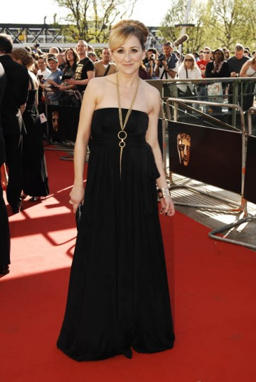 Charlotte Bellamy of Emmerdale fame arrived on the red carpet wearing a full length black gown with gold pendant necklace (BAFTA/Richard Kendal).