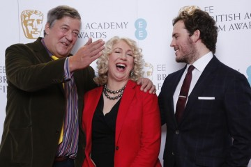 Sam Claflin, Stephen Fry and BAFTA Chair Anne Morrison pose for photos after announcing the nominations for the EE British Academy Film Awards in 2015