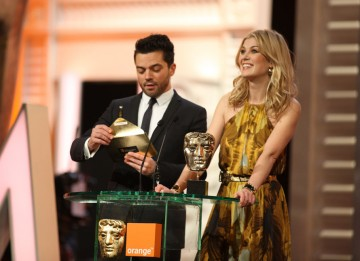Dominic Cooper (Tamara Drewe) and Rosamund Pike (Made In Dagenham) announce the Original Screenplay winner. (Pic: BAFTA/ Stephen Butler)