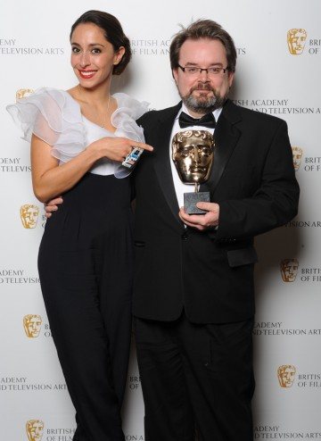 Charlie Philips shows off his  BAFTA for Editing Fiction with award presenter Oona Chaplin. Actress and grand-daughter of Charlie Chaplin.
