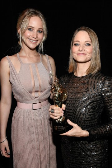 Jodie Foster poses with her Britannia Award presented to her by Jennifer Lawrence.