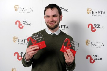 Steven Cameron Ferguson with his awards for Camera/Photography and Best New Work for 'Sick'.