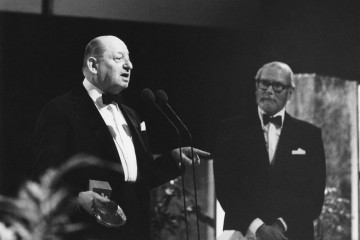 Lord Grade and Lord Olivier take to the stage at the British Academy of Film and Television Awards.