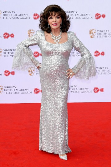 Joan Collins sparkles as she makes her entrance