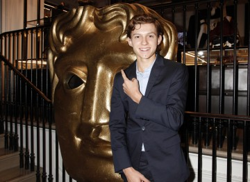 Tom Holland with the BAFTA mask at Burberry.