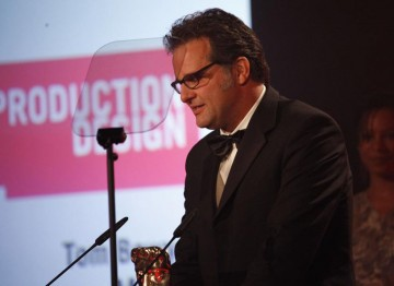 Tom Bowyer accepts the Television Craft Award for Production Design for his work on Misfits. (Pic: BAFTA/Jamie Simonds)