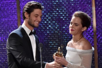 Honoree Emma Watson (R) accepts the Britannia Award for British Artist of the Year