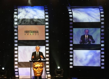 Steven Spielberg presented Daniel Day-Lewis with the Stanley Kubrick Britannia Award for Excellence in Film.