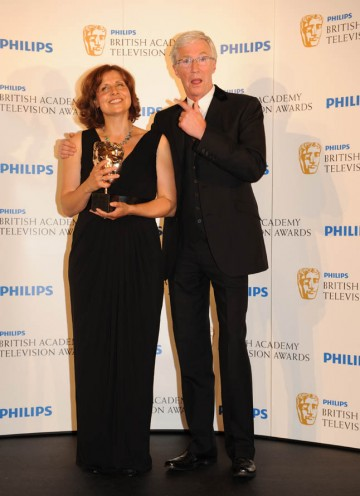 Rebecca Front, wiinner of Female Performance in a Comedy Programme for The Thick of It, with award presenter Paul O'Grady (BAFTA/Richard Kendal).