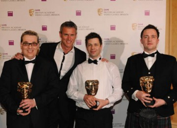 Gavin Raeburn, Clive Moody and Ralph Fulton received the Sport Award for Race Driver: GRID from Olympic swimmer Mark Foster (BAFTA / James Kennedy).