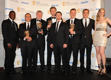 Romola Garai and Paterson Joseph present the Occupation team with their Drama Serial BAFTA (BAFTA/Richard Kendal).