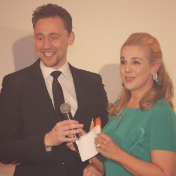 Tom Hiddleston helps with the auction
