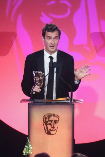 Julian Farino accepts the award for Director: Fiction sponsored by Mad Dog Casting at the British Academy Television Craft Awards in 2015