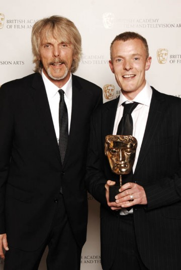 Martin Phipps celebrates his win in the Original Televisioin Music category for Wallander with Thin Lizzy's Scott Gorham, presenter of the award (BAFTA / Richard Kendal).