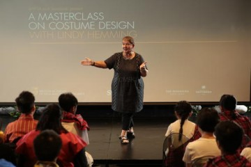 Hemming speaks to students at a local school about costume design