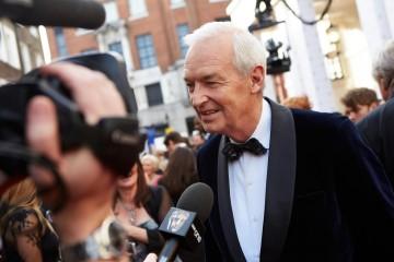 BAFTA Fellowship recipient Jon Snow provides an interview on the red carpet
