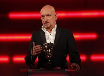 The BAFTA-winning actor, who voiced the King of Mist in Lionhead's Fable III, presents the Academy Fellowship to Lionhead's Peter Molyneux. (Pic: BAFTA/Brian Ritchie)