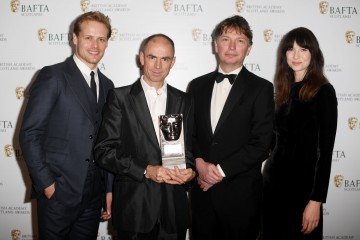 John Hodge & Andrew MacDonald with citation readers Sam Heughan & Caitriona Balfe, Feature Film