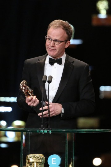 Spotlight screenwriter Tom McCarthy collects the award for Original Screenplay at the 2016 EE British Academy Film Awards