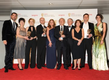 Lord Sugar and the team behind The Young Apprentice celebrate their BAFTA win alongside presenters Suranne Jones and Tom Ellis.