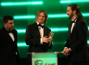 The BAFTA for Best Family Game is picked up by Mark Healey, Savid Smith and Pete Smith.