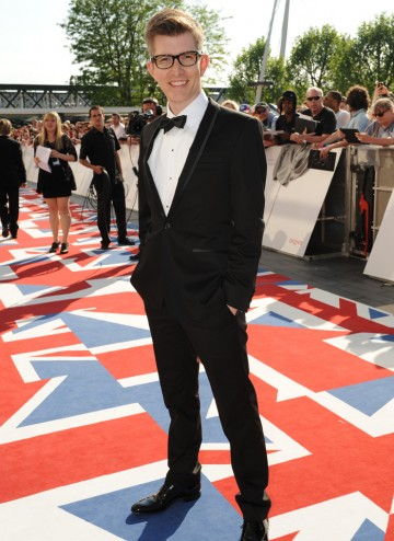 The BAFTA-winning choirmaster, in a Patrick Cox at House of Fraser suit,  will present the Features award with Downton Abbey's Joanne Froggatt.