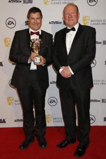 Ian Livingstone CBE presented the Fellowship to David Braben OBE.