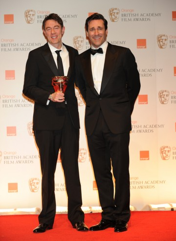 Presenter John Hamm with winning screenwriter Peter Straughan.