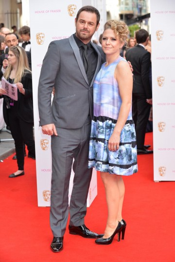 Danny Dyer and guest on the red carpet outside London's Theatre Royal