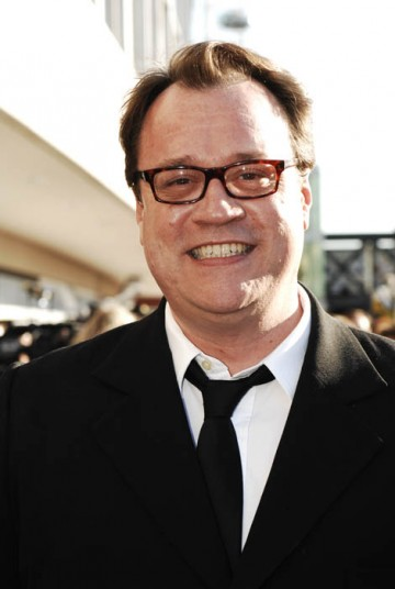 Doctor Who writer Russell T Davies smiles for the cameras on the red carpet (BAFTA / Richard Kendal).