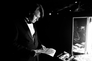 John Hanke checks his notes before presenting the award for Game Design