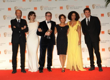 New Bond girls Berenice Marlohe and Naomie Harris with producer Eric Fellner, director Tomas Alfredson and producers Robyn Slovo and Tim Bevan.