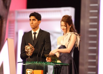 Dev Patel (Slumdog Millionaire) and Talulah Riley (St Trinian's) announce the Costume Design winner. (Pic: BAFTA/ Stephen Butler)