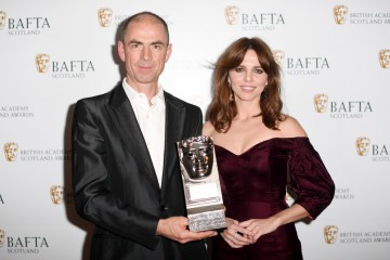John Hodge accepting on behalf of Ewen Bremner & citation reader Ophelia Lovibond, Actor Film