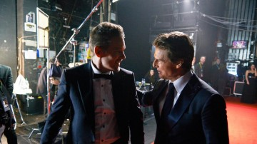 EE Rising Star Award winner Jack O'Connell talks backstage at London's Royal Opera House with Tom Cruise, presenter of the BAFTA for Film in 2015.