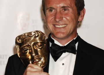 Bruce Parry, winner of the Factual Series Award for his adventure programme Amazon with Bruce Parry, celebrates backstage at the British Academy Television Awards in 2009 (BAFTA / Richard Kendal).