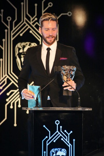 Troy Baker presents the award for Story