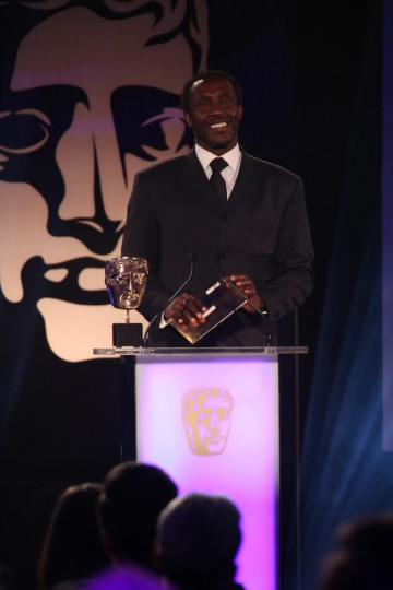 Linford Christie presents the award for Sport at the British Academy Games Awards Ceremony in 2015