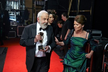 BAFTA Fellow Mike Leigh backstage at London's Royal Opera House with Supporting Actress nominee Imelda Staunton.