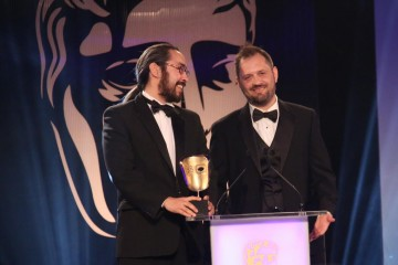 The team behind Never Alone (Kisima Ingitchuna) accept the award for Debut Game at the British Academy Games Awards in 2015
