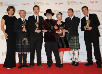 Presenter Kate Silverton, with the winning team, including Craig Hunter, Charlie Russell, Terry Pratchett, Rosie Marshall, Gary Scott and Rob Wilkins.
