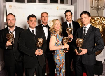 The team behind the BBC Winter Olympic titles celebrate their BAFTA win with Dr. Christian Jessen.